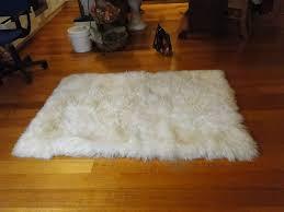 cozy pergo flooring with sheepskin rug for traditional family room design
