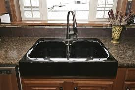 drop in double bowl black cast iron kitchen sink with nickel pull down faucet