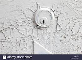 ling white paint covering an old garage door lock