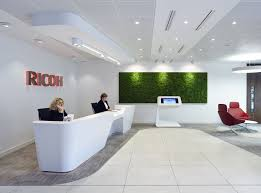 office reception interior. tech giant ricoh selected this mono desk and interactive media unit by isomi for their reception office interior