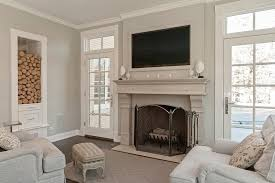 chicago tv over fireplace ideas with black tool sets family room traditional and firewood storage area