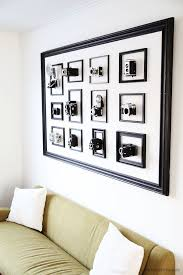 object i made for my livingroom i wanted something different than photos in a large frame so i made this hanging collection of vintage camera s i own  on pictures into wall art with how to turn your vintage camera collection into wall art pinterest