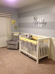 Adorable baby boy\u0027s nursery design with blue striped walls with ...