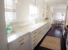 Of White Kitchens With Dark Floors The Eat In Galley Kitchen Features Dark Wood Floors Cabinets And