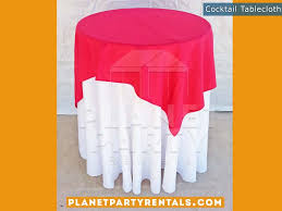 white round tablecloth on cocktail table with red overlay tablecloth linenals