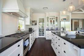 white kitchen cabinets with dark granite counters