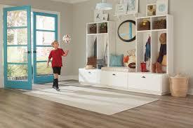area rug on hardwood floor in mud room