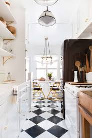 white traditional kitchen copper. Brady-Tolbert_Emily-Henderson_Black-and-White-Kitchen_Vintage_Apartment-Refresh_Wood_Brass_Checkered-Floor_Copper- White Traditional Kitchen Copper N