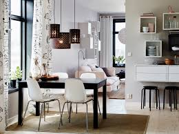 A medium-sized dining room furnished with a brown-black table with room for