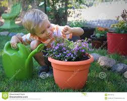 cute little boy helping with gardening and found an ant on the flower