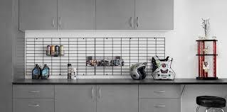 workbench with custom gridwall organization gridwall garage organizers above workbench