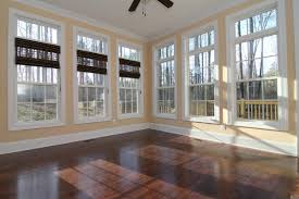 this large sunroom is filled with windows and upper transoms a ceiling fan es in handy when using the french door to move between indoor and outdoor