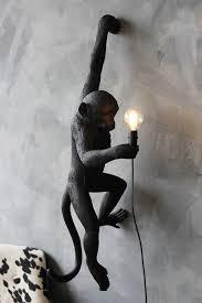hanging monkey wall lamp black