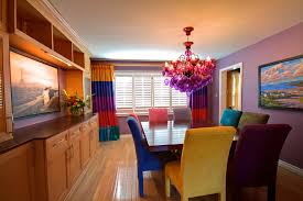 colorful dining chairs dining room eclectic with bold colors bright colors image by avalon interiors