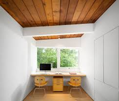 Minimalist home office design Simple This Bright White Minimalist Home Office Has Wood Ceiling And Floor While Floating Desk Has Enough Room For Two Contemporist 15 Home Offices Designed For Two People Contemporist