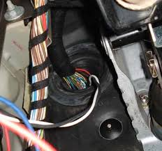 installing a trailer brake control in a range rover iii l322 lm view from lower left footwell cover panels removed showing the vehicle wiring harness going through the firewall the connector and wires for the