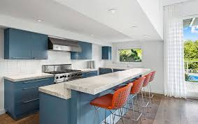 contemporary kitchen with blue cabinets and carrara white marble countertops
