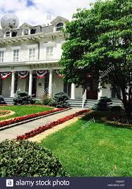 Designer Garden Flags House With American Flags And Designer Garden Stock Photo