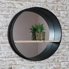 round metal wall mirror with shelf