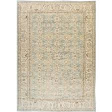 21st century modern blue and beige tabriz style rug for