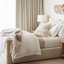 bedroom ralph lauren bedding in beige with white drum table lamp