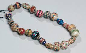 beads italy c 19th century gilded glass with applied threads and dots of coloured glass museum no 4553 2 1901 given by moses lewin levin