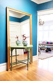 entryway furniture with mirror. large fulllength mirror behind a small entryway table furniture with