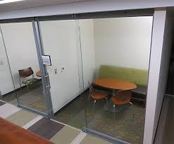 full height sliding glass office doors in college university wall