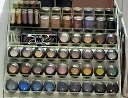 use a nail polish display rack to store your eyeshadow and makeup