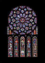 the north transept rose of chartres cathedral donated by blanche of castile it represents the virgin mary as queen of heaven surrounded by biblical kings