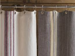 above the 72 by 70 inch rustic linen shower curtain is available in natural with red and indigo stripes or in gray with mustard and ivory for 180