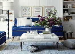 one kings lane blue slipcover sofa with white