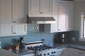 classic kitchen decorating ideas with white kitchen cabinet set and cool glass blue subway tile backsplash also grey granite countertops ideas