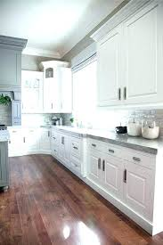 kitchens with black white cabinets dark granite or not ideas countertops