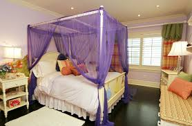 Purple Canopy Bed With Dark Wood Flooring For Small Spaces ...