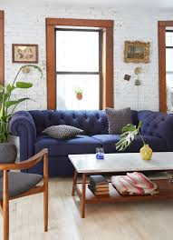 tufted sofa tiny living room transformation in nyc west elm buy west elm industrial storage coffee table