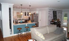 after photo of the whole house remodel for open concept kitchen bar and living room