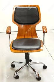 captivating modern wooden office chair with leather cushions stock photo contemporary office wooden office chairs designs