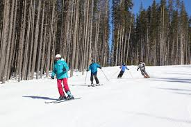 senior group skiing down the hill at lookout