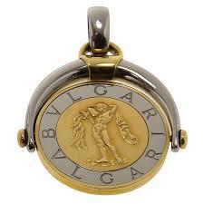 18k yellow gold aquarius zodiac flip medallion pendant nextprev prevnext