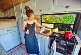 cooking in a diy campervan conversion kitchen