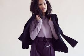 a model wearing a purple suit