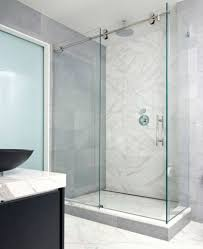 black vanity with white marble walls using minimalist clear glass sliding shower doors for modern bathroom ideas