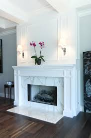 love the board and batten over fireplace/marble front. kitchen and den  Striking Marble Fireplace in Transitional Living Room