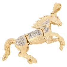 pre owned 9ct yellow gold cubic zirconia horse pendant jewellery from william may jewellers uk