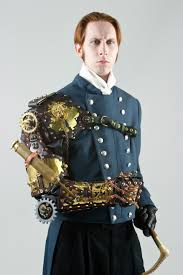 Author G. D. Falksen, wearing a steampunk-styled arm prosthesis (created by  Thomas Willeford), exemplifying one take on steampunk fashion.