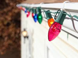 How To Fasten Christmas Lights To House How To Hang Christmas Lights Diy