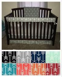 crib bedding set in white arrows on