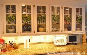hang wreaths on glass door kitchen cabinets