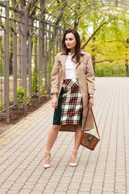 for an outfit that s so easy but can be dressed up or down in many diffe tan trenchcoat green and red plaid